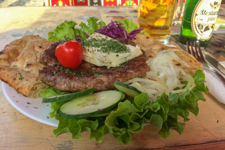 hamburger with vegetables on plate in mostar bosnia and herzegovina travel