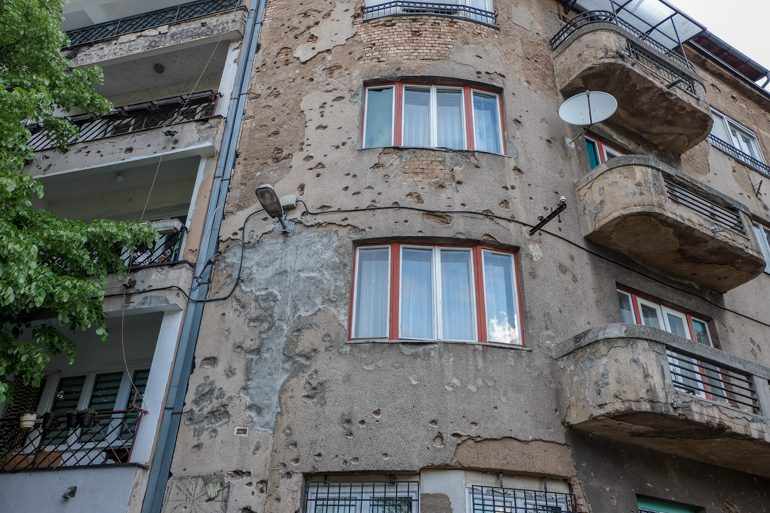 machine gun holes on apartment building in Sarajevo bosnia and herzegovina travel