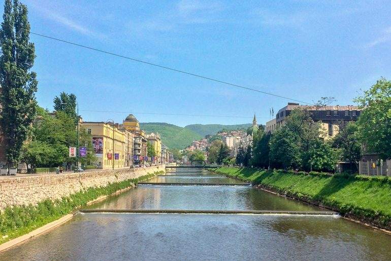 river lined with trees in sarajevo bosnia and herzegovina travel