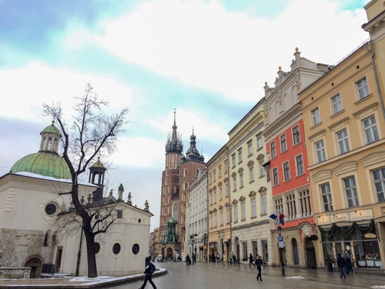 colourful buildings and red brick church in old town krakow 3 days itinerary