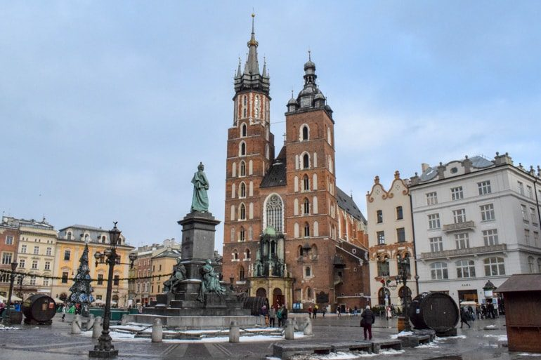 st marys red brick basilica basilica with statue in front in krakow main square 3 days in krakow