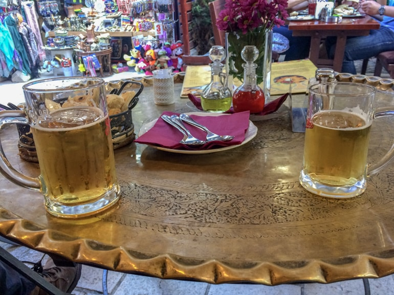 beers on gold metal table with bread best restaurants in sarajevo