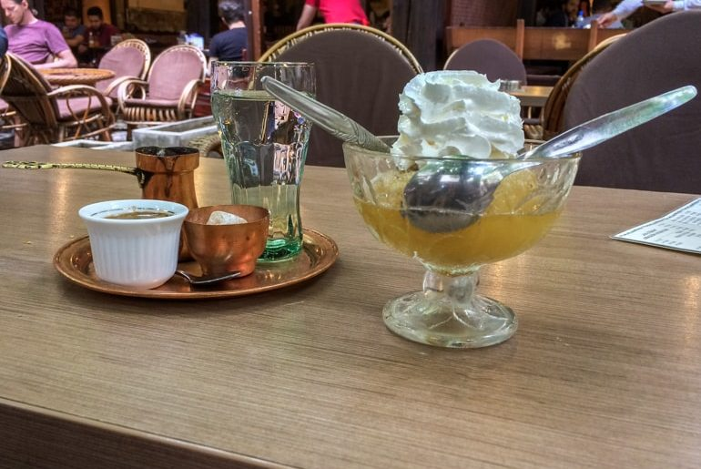 stuffed apple in bowl with spoons and turkish coffee best restaurants in sarajevo