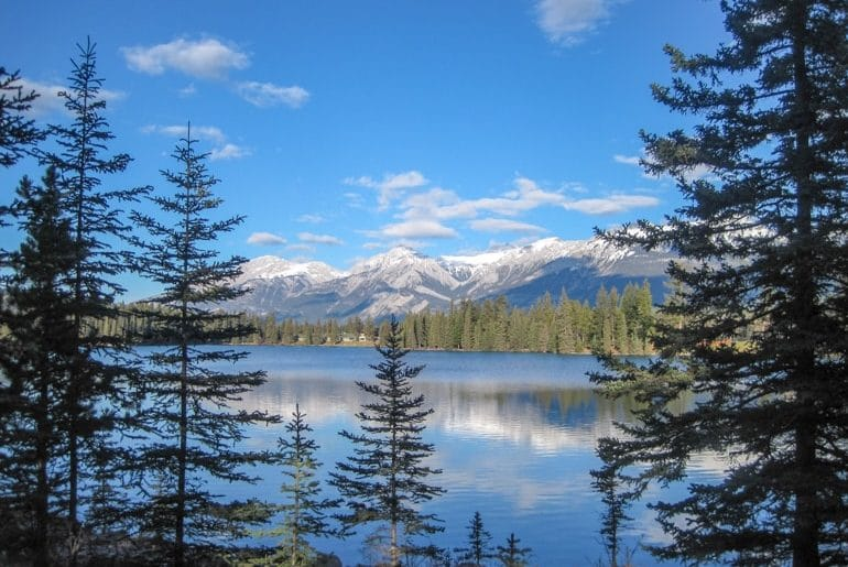 jasper blue lake with mountain and green pine trees canada sightseeing