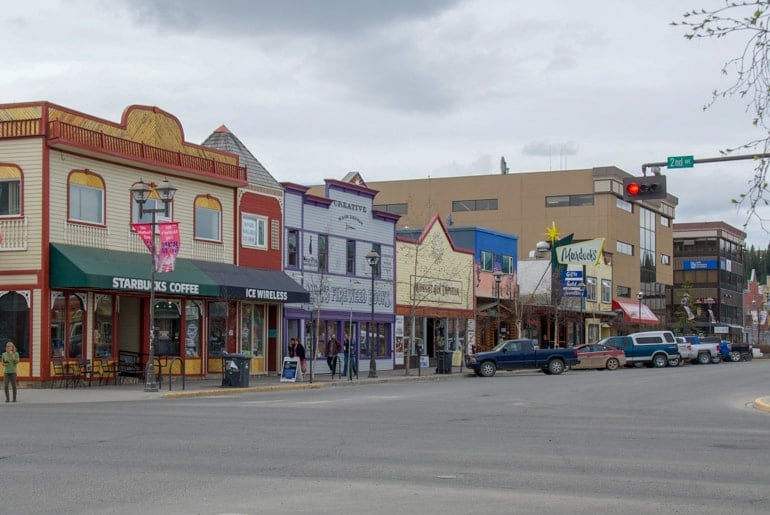 colourful shops along street in yukon canada sightseeing