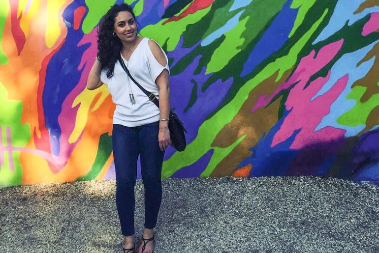 colourful graffiti wynwood walls with girl posing in front miami sightseeing