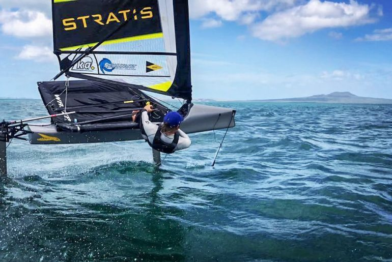 sailor man hanging off side of sailboat new zealand working holiday visa
