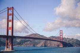 golden gate bridge with water under and blue sky san Francisco insider tips