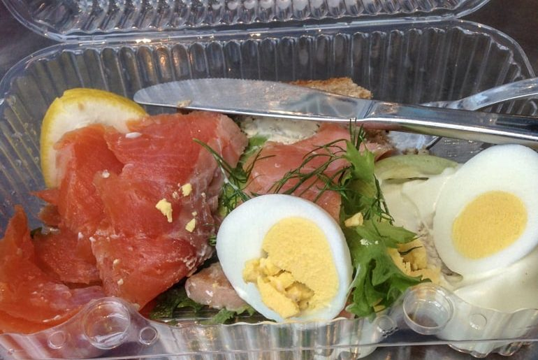 salmon and hard boiled eggs in plastic container on tallinn to helsinki ferry crossing