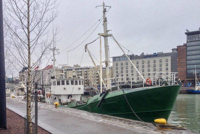 green boat tied up on pier in helsinki tallinn to helsinki ferry