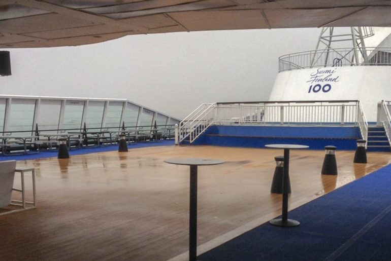 exterior top deck of ferry with blue carpet and railing tallinn to helsinki ferry