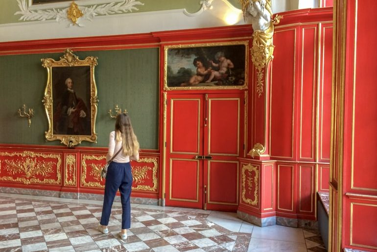 girl in red room with paintings things do to in aachen