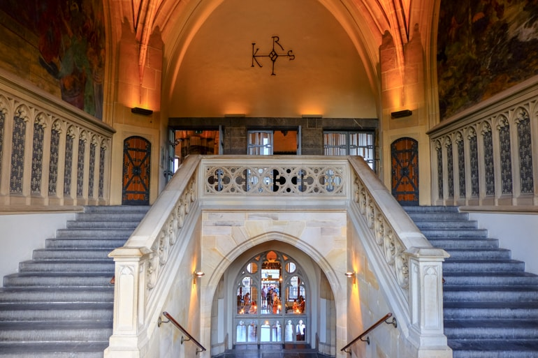 stone staircase with orange light and glass things to do in aachen