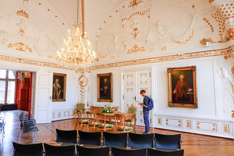 white and gold meeting room with boy standing things to do in aachen