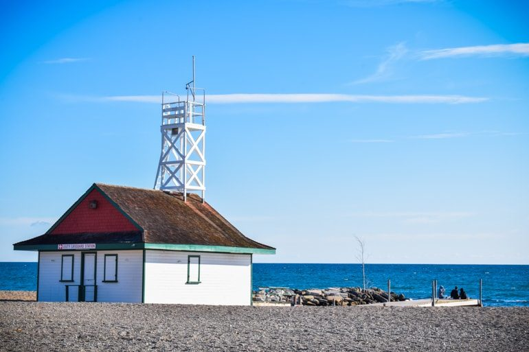 white wooden lifeguard with tower and blue sky and water travelling to canada for the first time