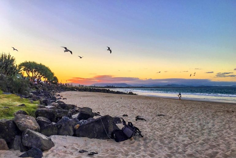 colourful sunset on sandy beach best places to visit in australia