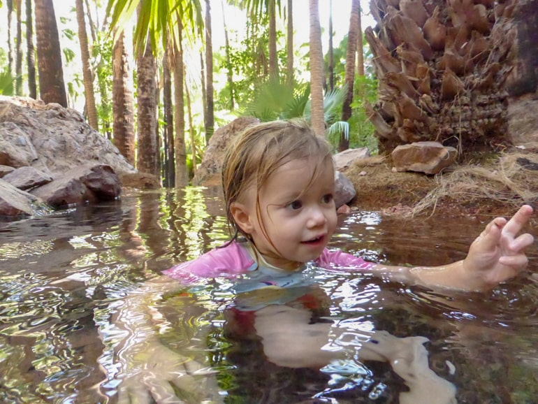 Small child enjoying water in Zebedee Springs Australia