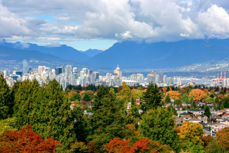 autumn leaves with downtown vancouver buildings best time of year to visit canada