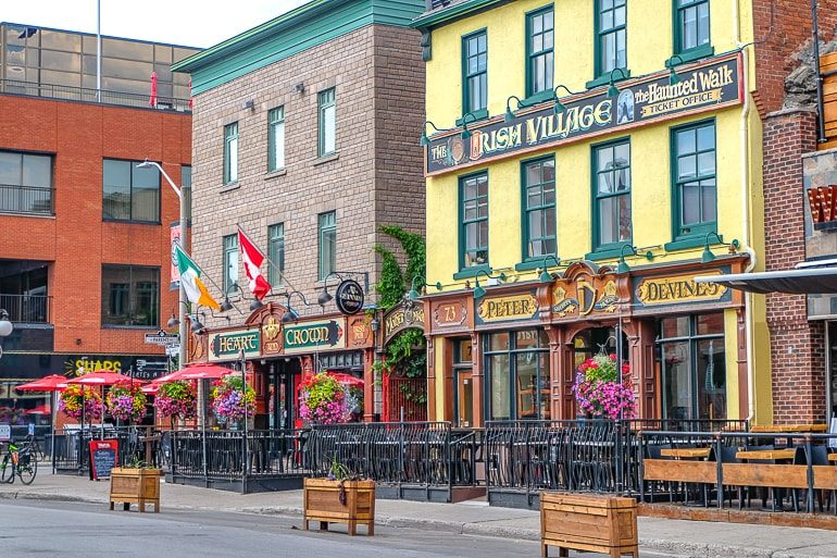 two traditional irish pub shop fronts with sidewalk in front ottawa pubs
