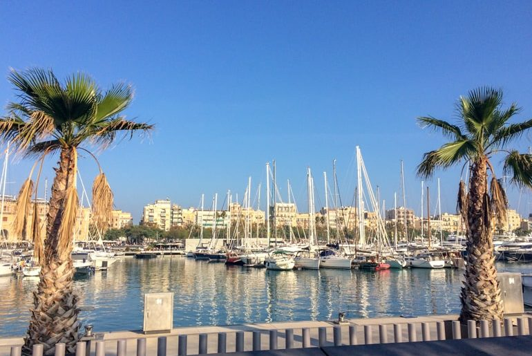 boats in blue harbour barcelona spain itinerary
