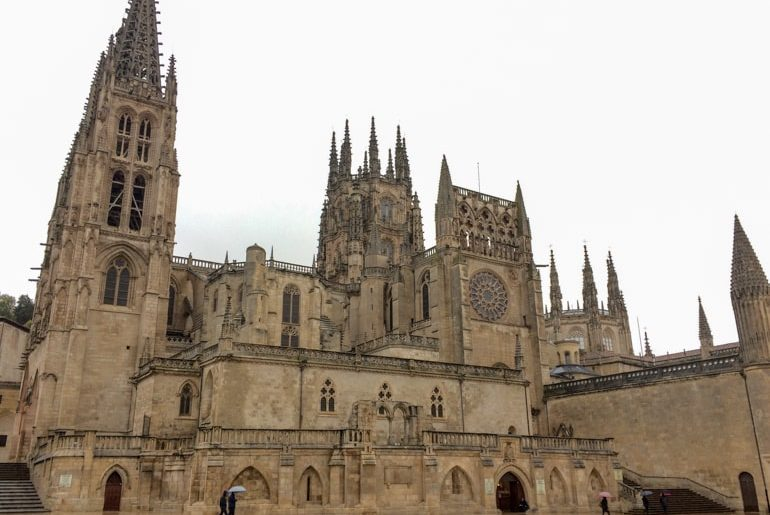 tan stone cathedral in rain burgos spain itinerary