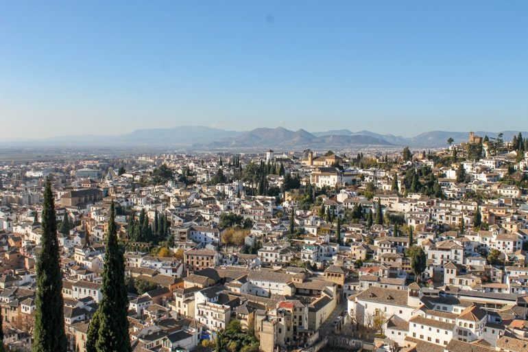 orange and white houses in granada spain itinerary