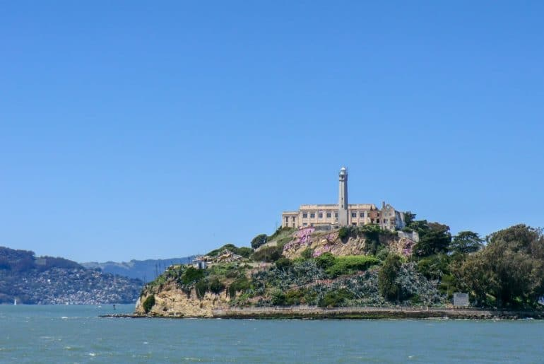 alcatraz island with blue sky and water top 10 things to do in san francisco