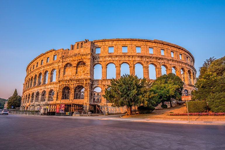 old roman style amphitheatre in red setting sun pula croatia