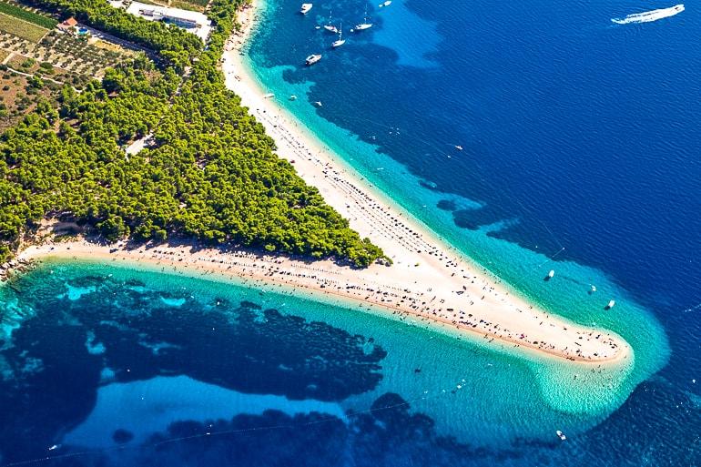 sandy point beach with blue ocean around croatian island of brac