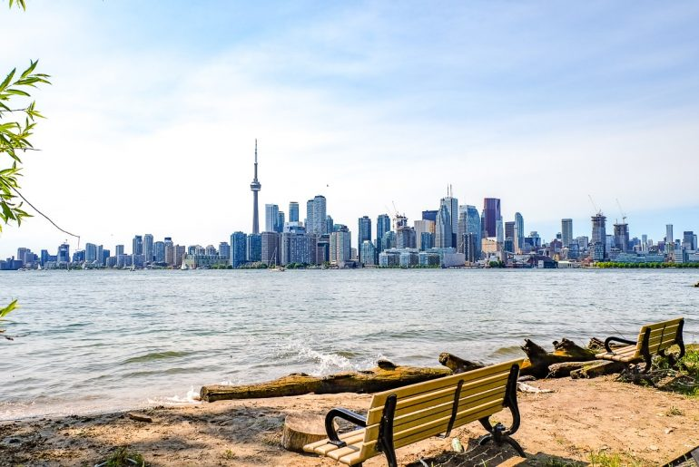 toronto skyline from toronto islands with beach and benches in front toronto tourist attractions