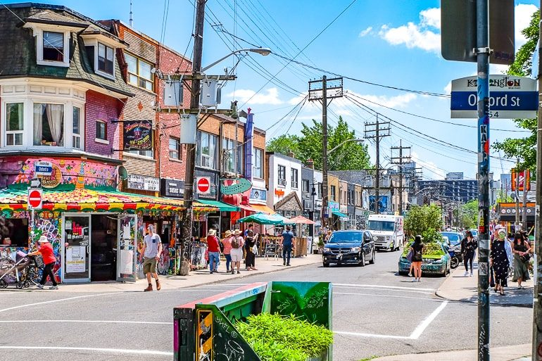 neighbourhood street with people and colourful shops kensington market toronto tourist attractions