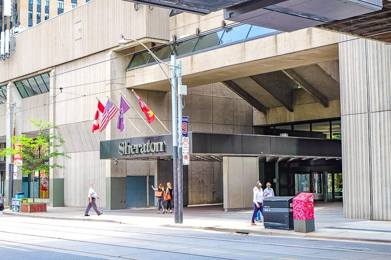 concrete hotel entrance with flags and sidewalk sheraton toronto