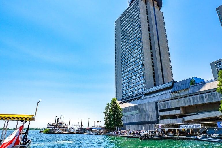 tall westin hotel building at toronto waterfront with boats in water