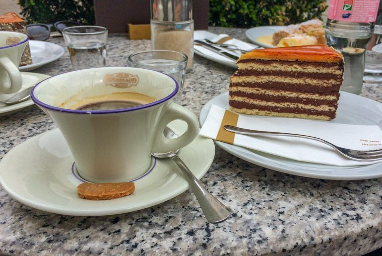 coffee and striped cake on marble table best cafes in budapest