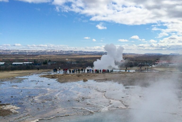 people watching geysir on golden circle tour iceland