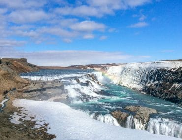 waterfall with blue water and rainbow golden circle tour iceland gullfoss