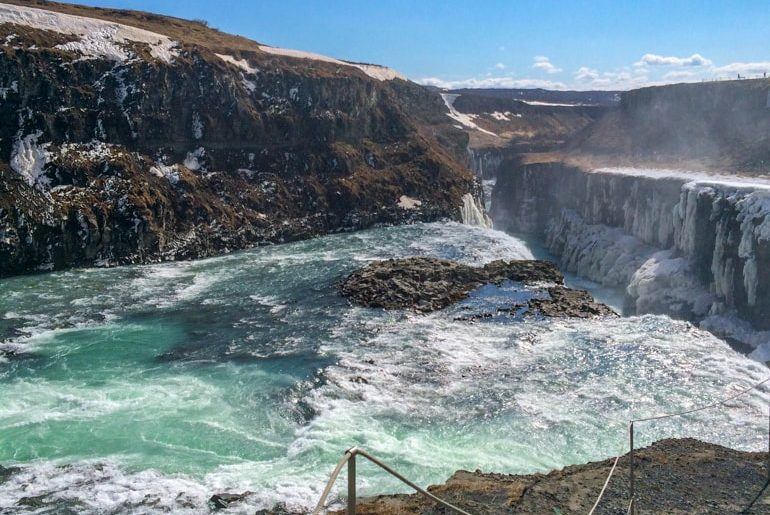 blue and white water with rock cliffs of water fall gullfoss golden circle tour iceland