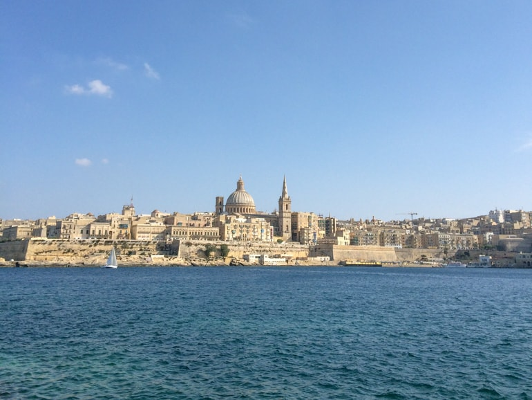 domed church and buildings with blue water valletta malta sightseeing