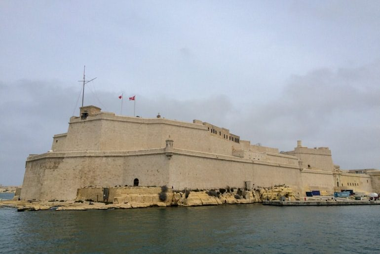 sandstone fort with water shoreline malta sightseeing
