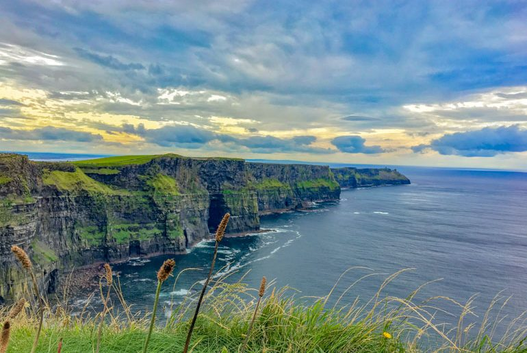 green cliffs with clouds and ocean things to do in dublin cliffs of moher