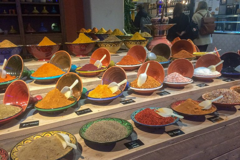 bowls of colourful spices on shelf at market things to do in eindhoven