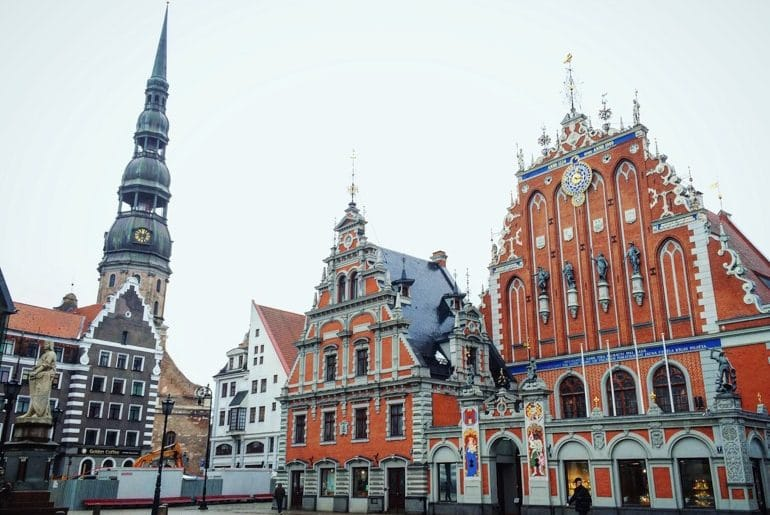 old colourful town hall in riga old town square travelling the baltics