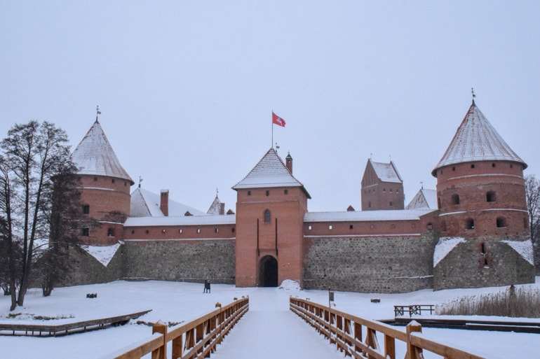 red brick castle in snow trakai travelling the baltics
