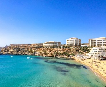 beach and resort hotels on cliff beside best places to stay in malta mellieha