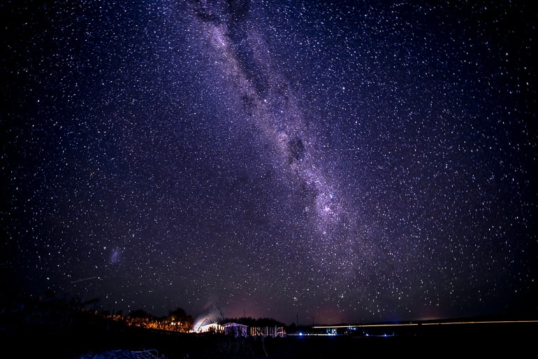 starry night sky with reflective ground experiences of a lifetime atacama desert