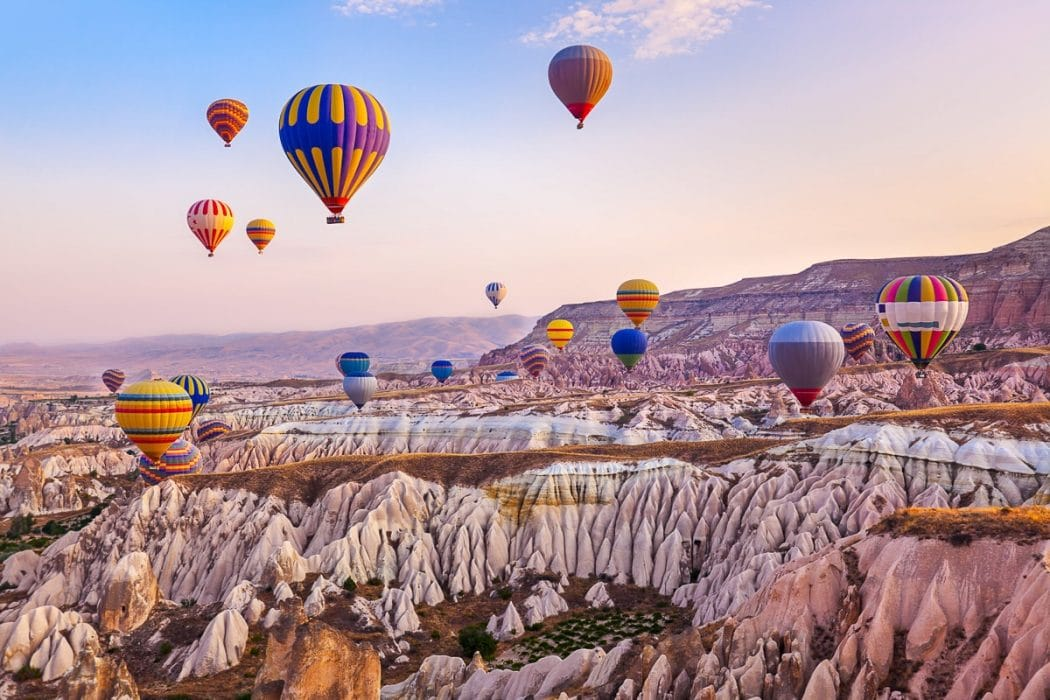 hot air balloons over pink rocky landscape turkey experiences of a lifetime