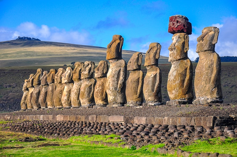 stone statues with green grass and blue sky experiences of a lifetime easter island
