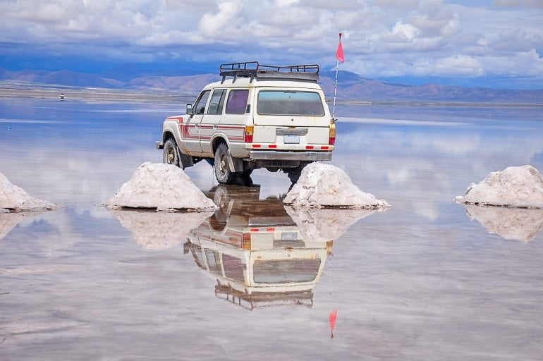 jeep on reflective salt flats experiences of a lifetime bolivia salt flats