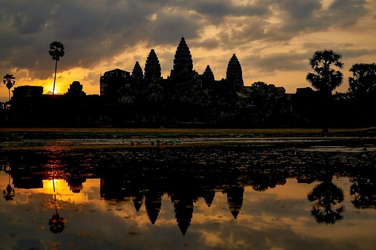 temples with water in front and sun rising experiences of a lifetime angkor wat