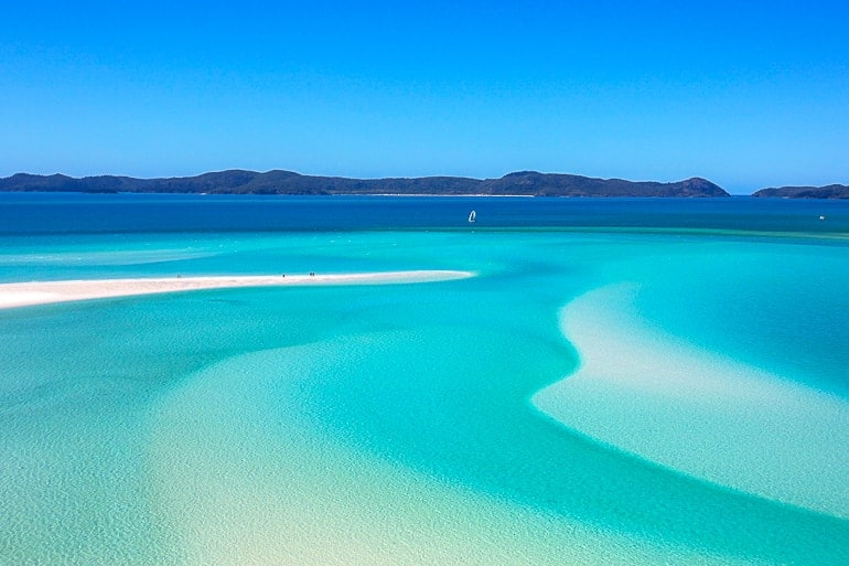 blue water with white sandy islands whitsunday islands australia